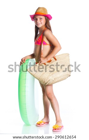 Cute girl in swimsuit holding swimming circle. Isolated on white background
