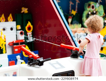 Cute girl in the amusement park Outdoors shoot - stock photo