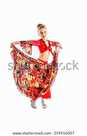 cute girl in traditional gypsy carnival costume, red  blouse, red yellow black flower fluffy skirt