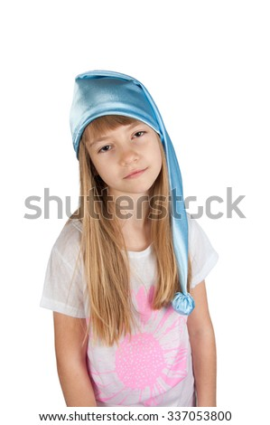 Cute girl in white pajamas and blue sleeping hat  isolated on white - stock photo