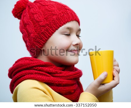 Cute girl is drinking tee - stock photo