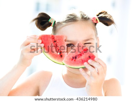 Cute girl is eating watermelon - stock photo