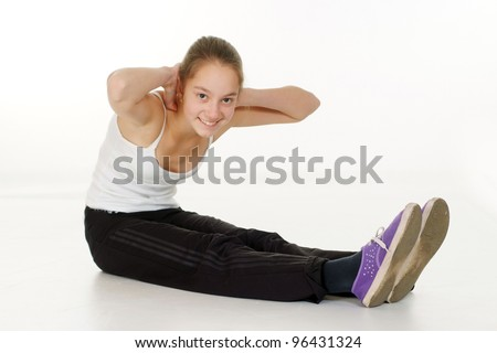 cute girl is engaged in fitness on the white floor
