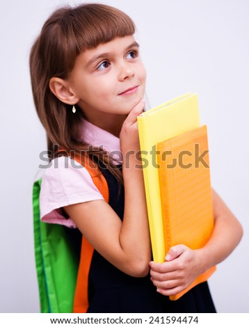 Cute girl is holding book - school concept
