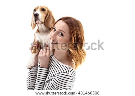 Cute girl is making fun with dog - stock photo