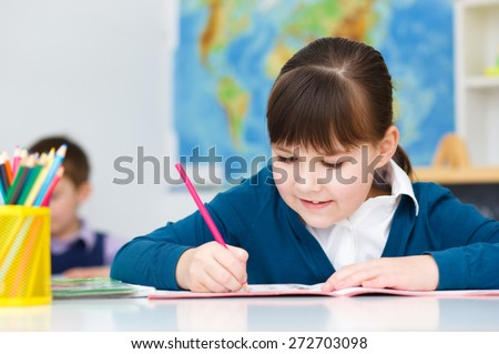 Cute girl is reading book - school, education concept - stock photo