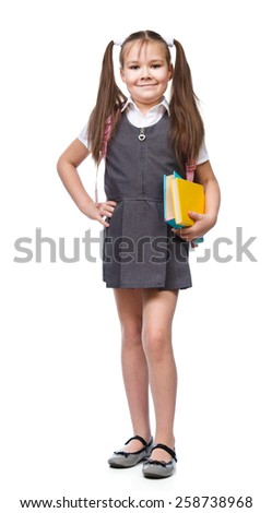 Cute girl is reading book - school, education concept, isolated over white - stock photo