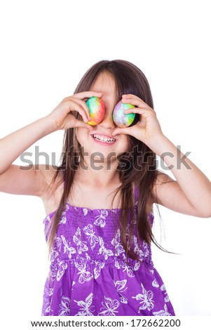 Cute girl keeping two decorated easter eggs - stock photo