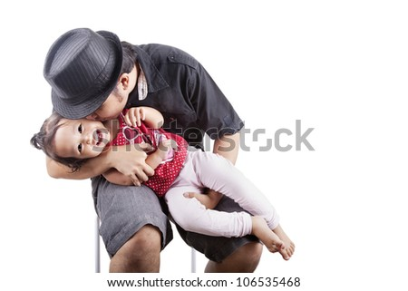 Cute girl kissed by her father, can be used as a symbol of father affection - stock photo