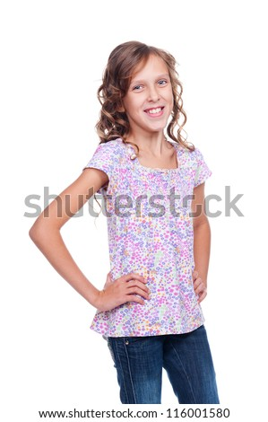 cute girl looking at camera and smiling. studio shot over white background - stock photo