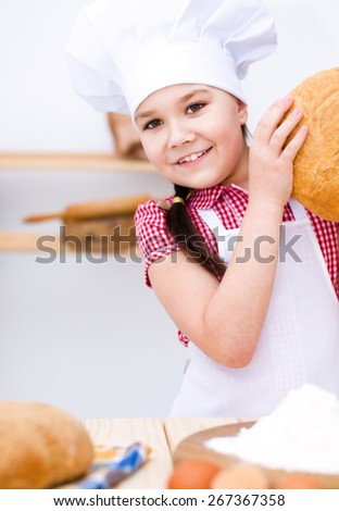 Cute girl making bread in the kitchen - stock photo