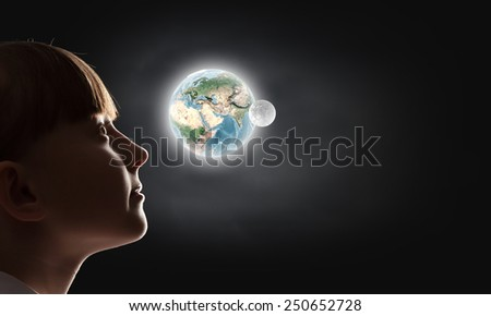 Cute girl of school age against night background. Elements of this image are furnished by NASA