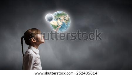 Cute girl of school age looking at Earth planet. Elements of this image are furnished by NASA - stock photo