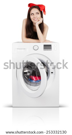Cute Girl on a Washing Machine Filled with Laundry - Young happy housewife smiling while doing laundry