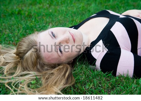 cute girl on green grass - stock photo