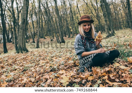 stock photo cute girl outdoors young woman in autumn forest relaxing with leaves 749268844 - Sizzling hot Slava Young women