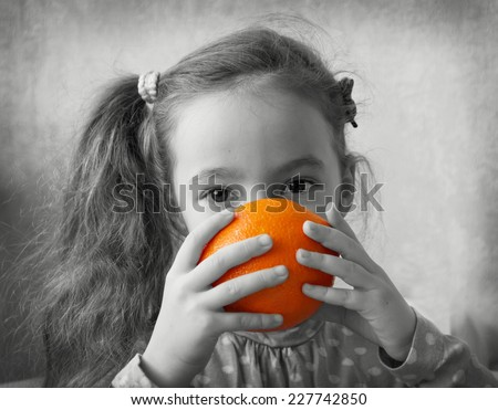 Cute girl play with oranges - stock photo
