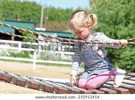 Cute girl playing at the playground  - stock photo