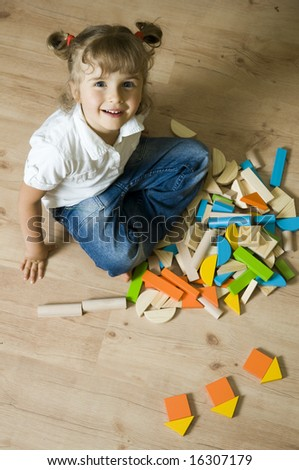 Cute girl playing with blocks - stock photo
