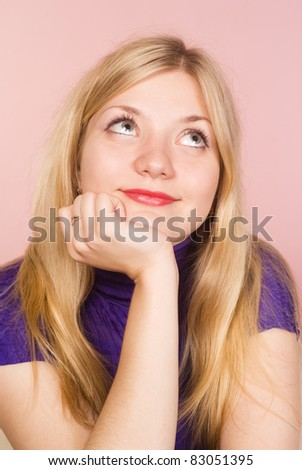 cute girl posing on a pink background