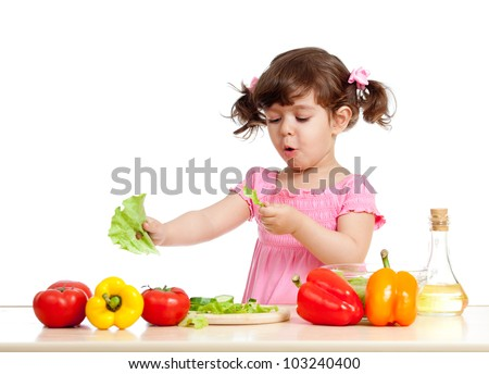 cute girl preparing healthy food vegetable salad - stock photo