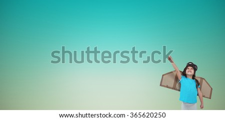 Cute girl pretending to be pilot against blue green background - stock photo