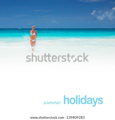 Cute girl runs out of the sea with water splash, beautiful clean beach, luxury resort in the Mexico, summer holidays concept