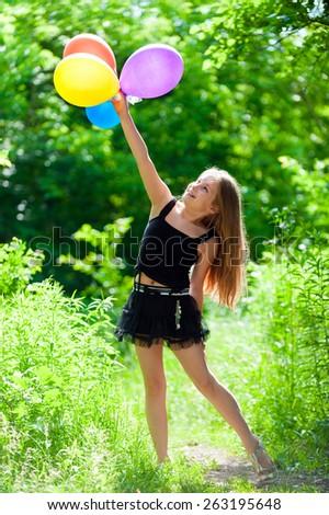 Cute girl school age walks on spring green parkland. - stock photo
