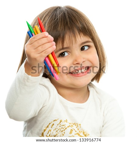 Cute girl showing color wax crayons.Isolated on white. - stock photo
