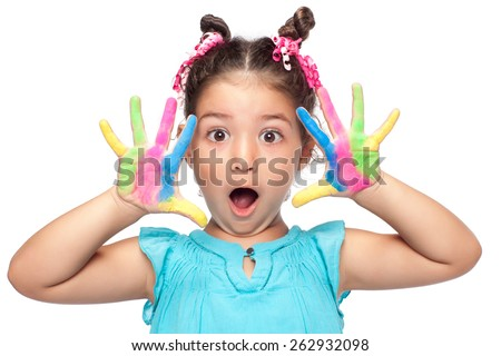 Cute girl showing her colorful hands surprised - stock photo