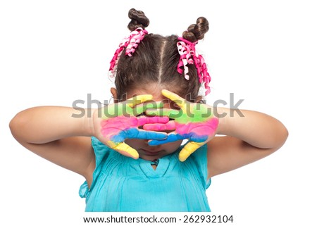 Cute girl showing hiding her face - stock photo