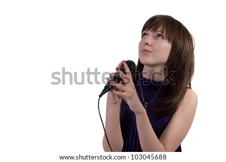 Cute girl singing into a microphone on a white background