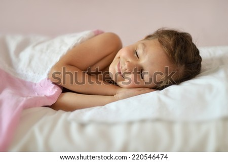 Cute girl sleeping in her bed at home - stock photo