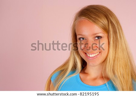 cute girl smiling on a pink background