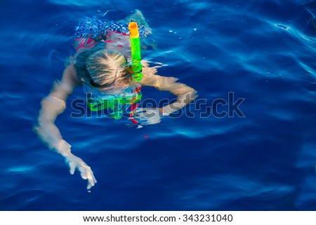 Cute girl snorkeling in water mask in the red sea - stock photo