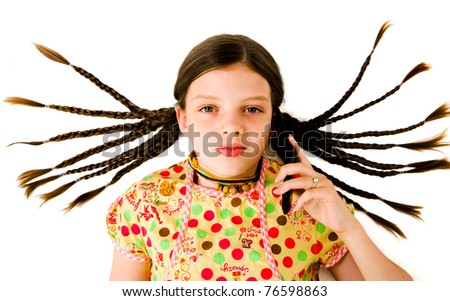 Cute girl talking on a mobile phone isolated over white - stock photo