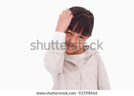 Cute girl thinking against a white background