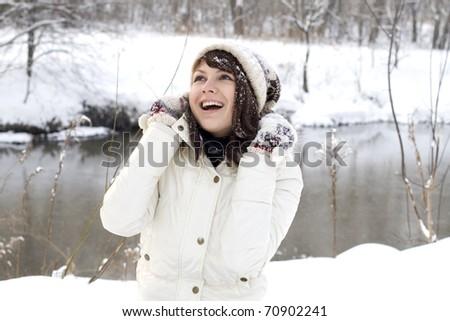 Cute girl walking in winter forest - stock photo