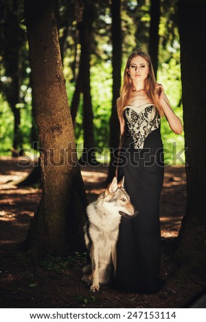 cute girl walking with a dog on the morning forest - stock photo