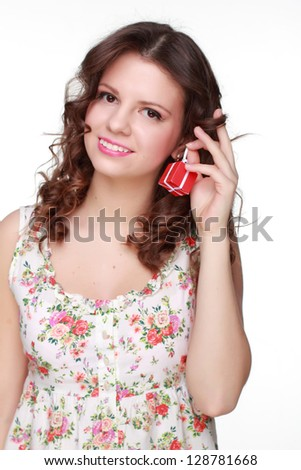 Cute girl wearing clothes with floral ornament on white background - stock photo