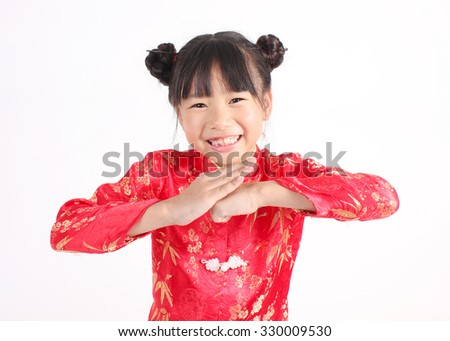 Cute girl wearing red Chinese suit  - stock photo