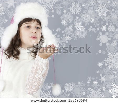 cute girl white dressing blow snowflakes, christmas