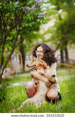 Cute girl with a dog on the street - stock photo