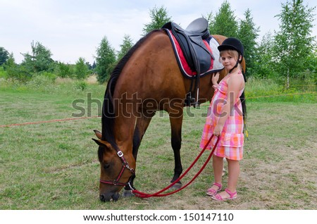 Cute girl with arabian horse - stock photo