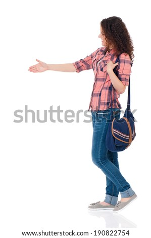 Cute girl with bag waving a greeting, isolated on white background  - stock photo