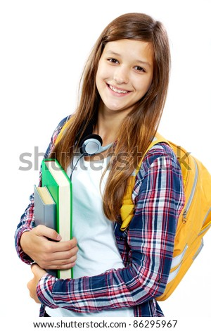Cute girl with books smiling at camera in isolation - stock photo