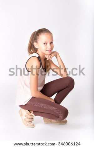 Cute girl with brown clothes posing on a white background - stock photo