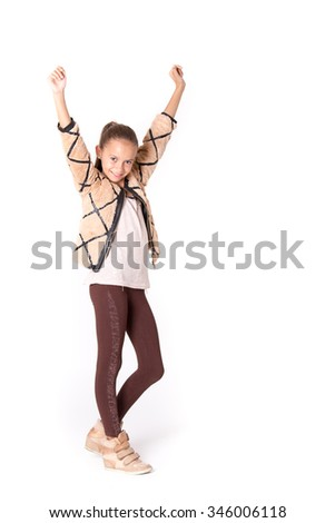 Cute girl with brown clothes posing victoriously isolated on white - stock photo