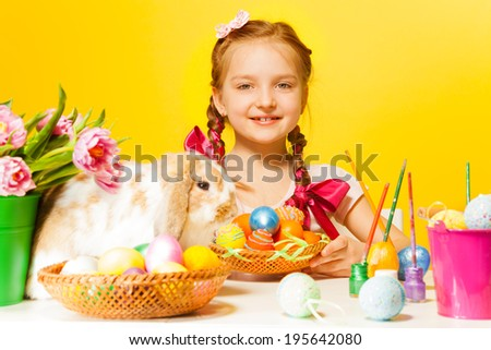 Cute girl with Eastern eggs and cute rabbit - stock photo