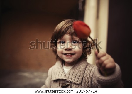 Cute girl with flower portrait - stock photo